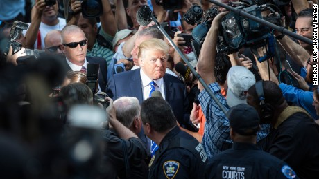 NEW YORK, NY - AUGUST 17:  Republican Presidential hopeful Donald Trump arrives at Manhattan Supreme Court to report for jury duty on August 17, 2015 in New York City. Trump spent the last few days on the campaign trail at the Iowa state fair before returning to New York to perform the civic duty.  (Photo by Andrew Burton/Getty Images)