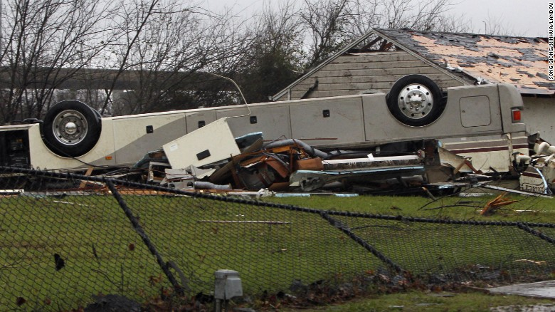 A bus lays overturned in Garland, Texas, on December 27.