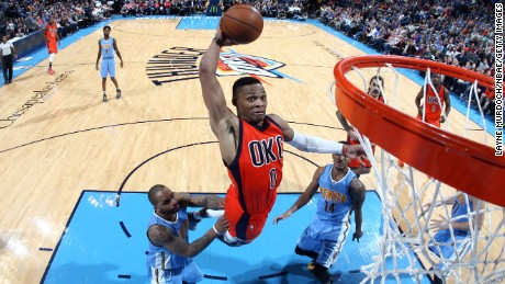 OKLAHOMA CITY, OK - DECEMBER 27:  Russell Westbrook #0 of the Oklahoma City Thunder goes to the basket against the Denver Nuggets on December 27, 2015 at Chesapeake Energy Arena in Oklahoma City, Oklahoma. NOTE TO USER: User expressly acknowledges and agrees that, by downloading and or using this photograph, User is consenting to the terms and conditions of the Getty Images License Agreement. Mandatory Copyright Notice: Copyright 2015 NBAE (Photo by Layne Murdoch/NBAE via Getty Images)'