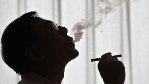 The inventor of the electronic cigarette, Hon Lik, smoking his invention in Beiijng on May 25, 2009.