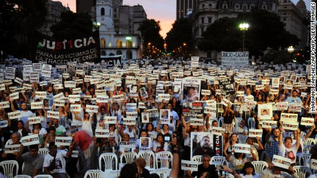 Relatives and friends of the 52 victims of a commuter train accident of 2012 at Once station, demonstrate in demand of justice at Mayo sqaure in Buenos Aires on February 22, 2014, on the second anniversary of the disaster. AFP PHOTO / NA - MARIANO SANCHEZ        (Photo credit should read MARIANO SANCHEZ/AFP/Getty Images)