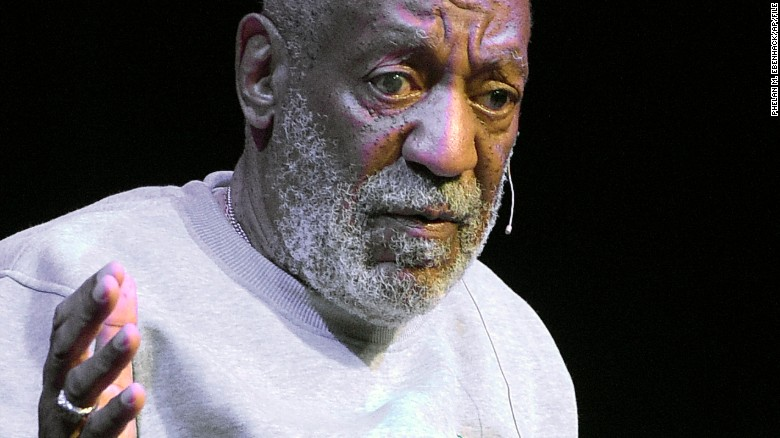 FILE - In this Friday, Nov. 21, 2014, file photo, comedian Bill Cosby performs at the Maxwell C. King Center for the Performing Arts, in Melbourne, Fla. Lawyers for Cosby say they will fight an attempt to require the comedians wife to give a sworn deposition in a defamation lawsuit filed by seven women who have accused Cosby of sexually assaulting them decades ago. A lawyer for the women has subpoenaed Camille Cosby to be deposed on Jan. 6, 2016, at a Springfield hotel. (AP Photo/Phelan M. Ebenhack, File)