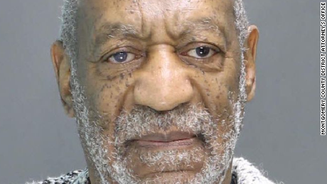 How did Bill Cosby act during arraignment?