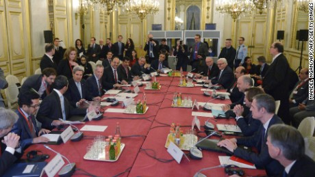 A general view shows US Secretary of State John Kerry (4th L, seated), French Foreign Minister Laurent Fabius (4th R) and other leaders at the start of the ministerial meeting on Syria at the Quai d'Orsay, Ministry of Foreign Affairs, in Paris on December 14, 2015. / AFP / POOL / MANDEL NGAN        (Photo credit should read MANDEL NGAN/AFP/Getty Images)