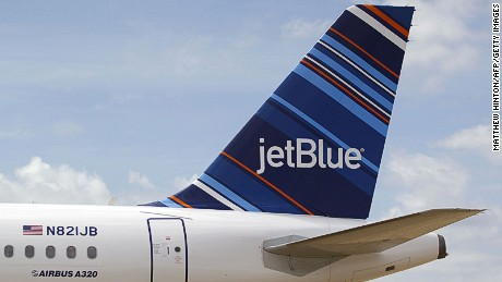 A JetBlue A320 is parked at Brookley Field after a ground breaking ceremony for an assembly line for the Airbus A320 at Brookley Aeroplex in Mobile, Alabama on April 8, 2013. AFP PHOTO/ Matthew Hinton (Photo credit should read Matthew HINTON/AFP/Getty Images)