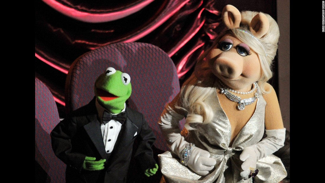 "Does Kermit the Frog count as a great TV host? Why not? If you had to deal with the Swedish Chef, the Electric Mayhem, a corny comedian bear and that diva pig, you'd probably go nuts. But Kermit is usually soft-spoken and gracious ... that is, when he's on stage. As a producer, <a href=""http://www.hitfix.com/whats-alan-watching/review-the-muppets-takes-an-unfortunately-dark-turn-with-kermit-friends"" target=""_blank"">things have sometimes been different.</a>"