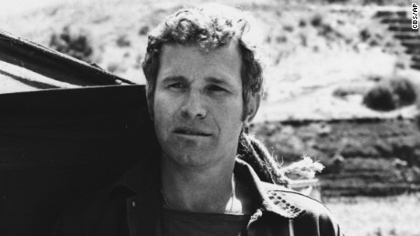 """In this photo provided by CBS, Wayne Rogers poses for a photo in his character of Trapper John McIntyre from the television series """"M*A*S*H,"""" in an undated photo. Rogers has died. The actor was surrounded by family when he died Thursday, Dec. 31 in Los Angeles of complications from pneumonia at age 82, his publicist and longtime friend Rona Menashe told The Associated Press."""