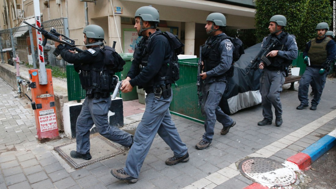 Security forces patrol the area after the shooting.