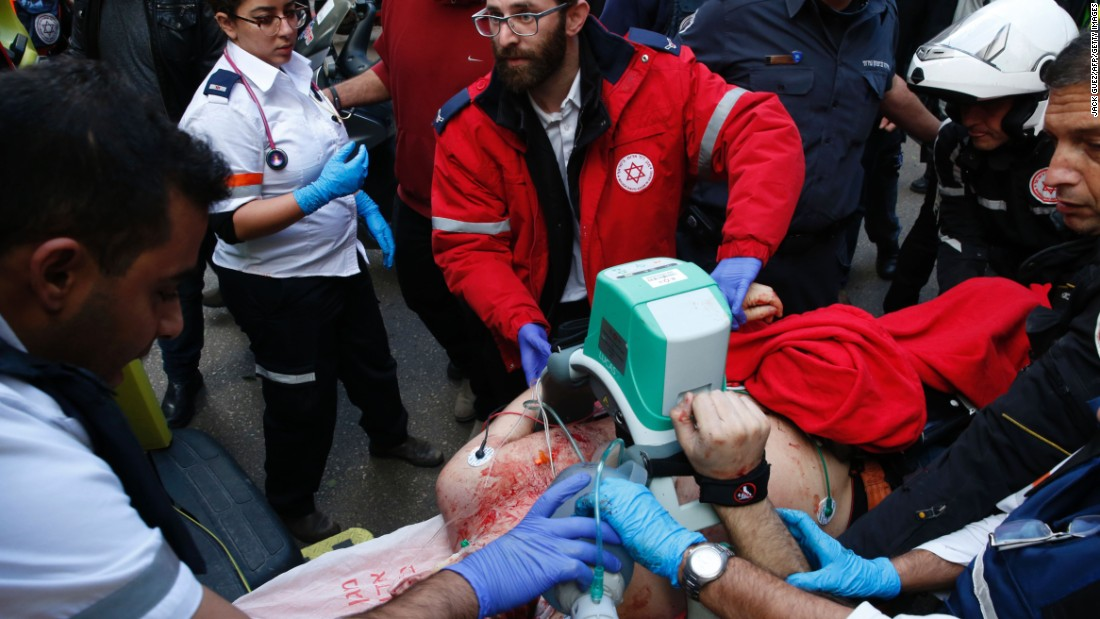 Medics give emergency treatment to a victim.