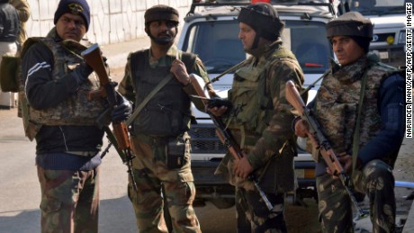 Indian security personnel stand alert on a road leading to an airforce base in Pathankot on January 2, 2016, during an ongoing attack on the base in the northern Indian state of Punjab by suspected militants.  Suspected Islamist gunmen have staged a pre-dawn attack on a key Indian air base near the Pakistan border with two militants killed in a shootout, officials said, striking a blow to the neighbours' fragile peace process. AFP PHOTO/NARINDER NANU / AFP / NARINDER NANU        (Photo credit should read NARINDER NANU/AFP/Getty Images)