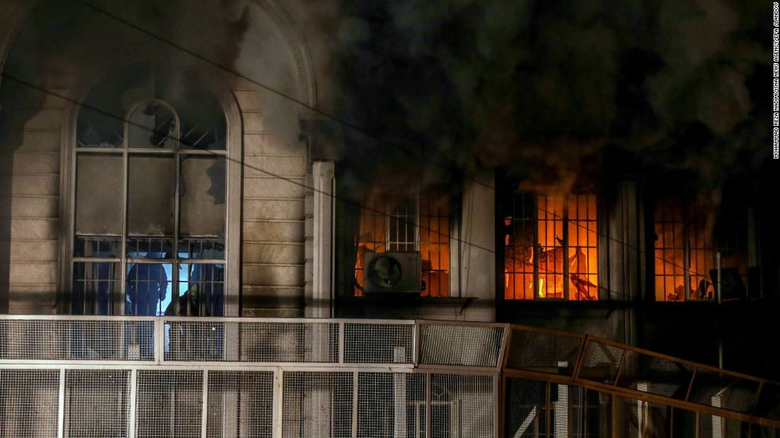 Smoke billows from the windows of the burning Saudi Embassy. A CNN producer in Tehran said some protesters made it inside the building, setting fire and ransacking some records.