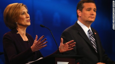 Presidential candidate Carly Fiorina (L) while Sen. Ted Cruz (R-TX) looks during the CNBC Republican Presidential Debate at University of Colorados Coors Events Center October 28, 2015 in Boulder, Colorado.
