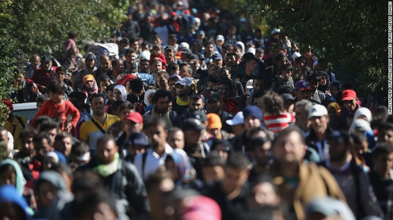 Hundreds of migrants walk on the border between Hungary and Austria in September 2015.