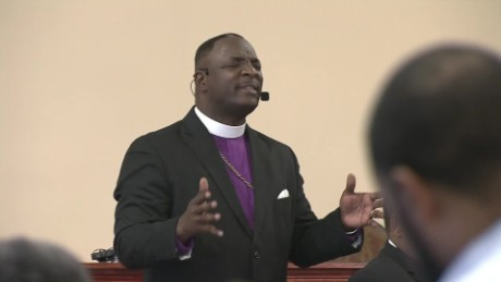 Pastor calmly disarms armed man in church
