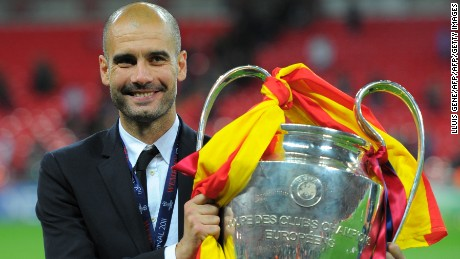 Barcelona's Spanish coach Josep Guardiola celebrates with the trophy at the end of the UEFA Champions League final football match FC Barcelona vs. Manchester United, on May 28, 2011 at Wembley stadium in London.Barcelona won 3 to 1. AFP PHOTO / LLUIS GENE (Photo credit should read LLUIS GENE/AFP/Getty Images)