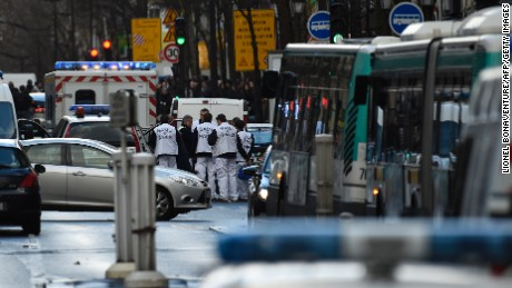 "Rescue workers are seen at the Boulevard de Barbes in the north of Paris on January 7, 2016, after police shot a man dead as he was trying to enter a police station in the Rue de la Goutte d'Or. The man shot dead by police on the first anniversary of the jihadist assault on Charlie Hebdo had a knife and what appeared to be an explosives vest, the government said. The man was also heard to shout ""Allahu Akbar"" as he approached the police station in the multi-ethnic neighbourhood in the north of the capital, the interior ministry said. AFP PHOTO / LIONEL BONAVENTURE / AFP / LIONEL BONAVENTURE        (Photo credit should read LIONEL BONAVENTURE/AFP/Getty Images)"