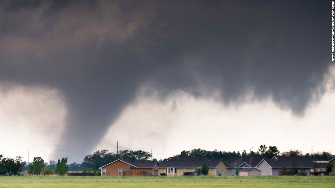 A large tornado passes just to the west of Halstead, Kansas, on May 6. As many as 178 tornadoes were reported across nine states from May 6-10.  The month of May sees more tornadoes than any other month in the United States.  <br />