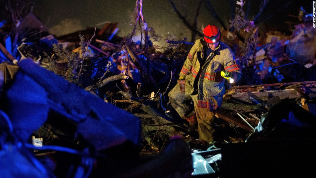 Crews search wreckage on State Route 72 after an EF-4 tornado came through Fairdale, Illinois, on April 9. It was the strongest of almost 50 tornadoes that occurred between April 7-9 across eight states. The tornado in Fairdale had winds up to 200 mph and left two people dead.