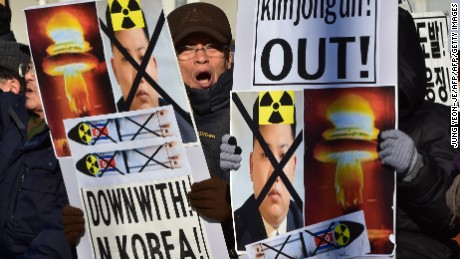 "South Korean conservative activists shout slogans with placards showing portraits of North Korean leader Kim Jong-Un during a rally denouncing North Korea's hydrogen bomb test, in Seoul on January 7, 2016. The US and South Korean presidents vowed on January 7 to impose the ""most powerful and comprehensive"" sanctions on North Korea after its globally condemned fourth nuclear test. AFP PHOTO / JUNG YEON-JE / AFP / JUNG YEON-JE        (Photo credit should read JUNG YEON-JE/AFP/Getty Images)"