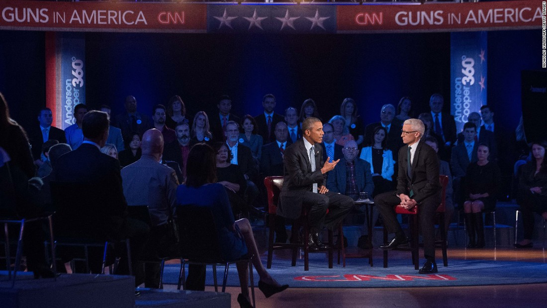 "U.S. President Barack Obama speaks about guns at a town-hall meeting in Fairfax, Virginia, on Thursday, January 7. During the event, moderated by CNN's Anderson Cooper, Obama rejected the ""imaginary fiction"" that he wanted to take away the guns of law-abiding Americans. He said his opponents had twisted his plans on gun safety measures."