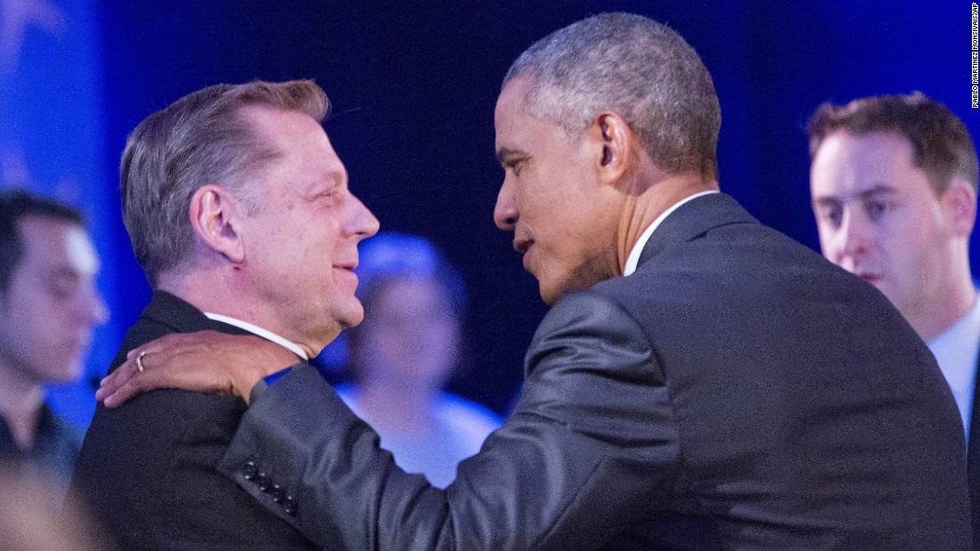 Obama stops to greet the Rev. Michael Pfleger, a noted gun control activist from Chicago, during a commercial break.