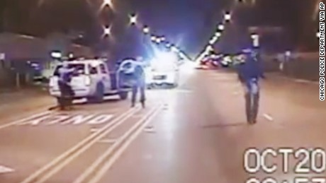 FILE - In this Oct. 20, 2014 frame from dash-cam video provided by the Chicago Police Department, Laquan McDonald, right, walks down the street moments before being shot by officer Jason Van Dyke 16 times in Chicago. Chicago officials released hundreds of emails Thursday Dec. 31, 2015 related to the video that wasn't released until more than a year after the shooting.  The emails, including some between city officials asking how they should respond to demands for the video, were released to media outlets that have been pressing for the documents for weeks.  (Chicago Police Department via AP, File)