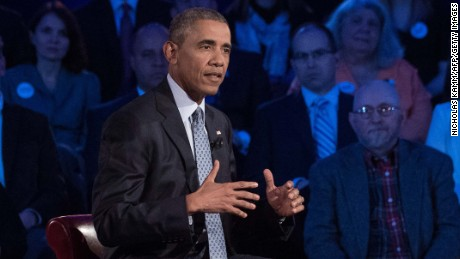 US President Barack Obama speaks at a town hall meeting with CNN's Anderson Cooper on reducing gun violence at George Mason University in Fairfax, Virginia, on January 7, 2016.