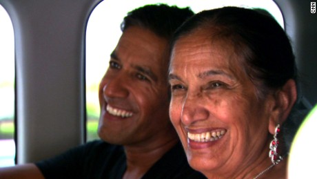"Dr. Sanjay Gupta and his mother, Damyanti, trace their ancestry for CNN's ""Roots"" series June 8, 2014 in Tharushah, Pakistan."