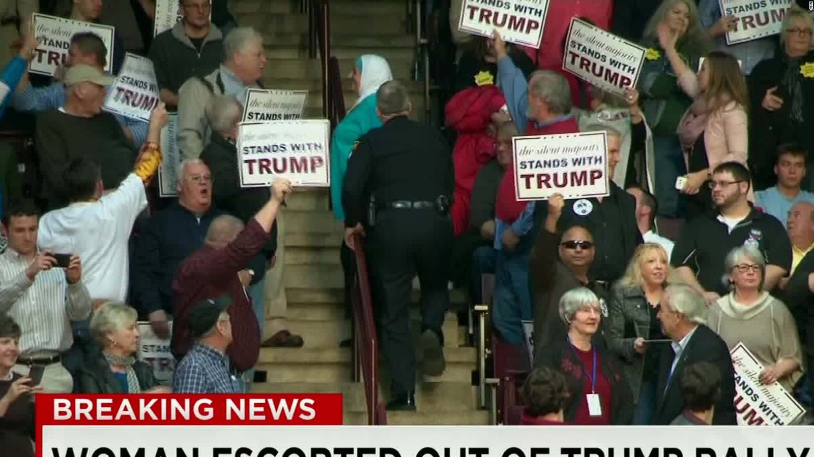 Silently protesting Muslim woman ejected from Trump rally