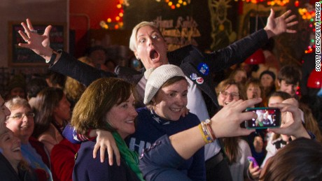 Screenwriter and actress Lena Dunham is photobombed by former U.S. Women's National Soccer Team captain Abby Wambach while taking a selfie after talking to a crowd at a Hillary Clinton for President event on January 8, 2016 in Manchester, New Hampshire.