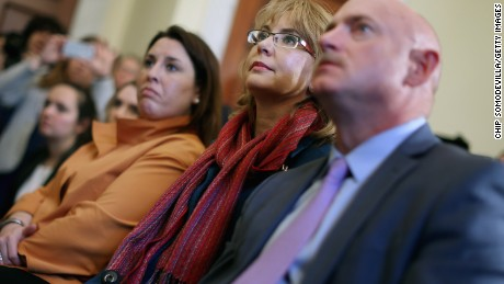 Former Congresswoman and handgun violence survivor Gabby Giffords (C), her husband Mark Kelly (R) and Americans for Responsible Solutions Executive Director Hayley Zachary attend a news conference about background checks for gun purchases at the Canon House Office Building on Capitol Hill March 4, 2015 in Washington, DC.
