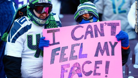 A Seattle Seahawks fan holds a sign during the wild card ...