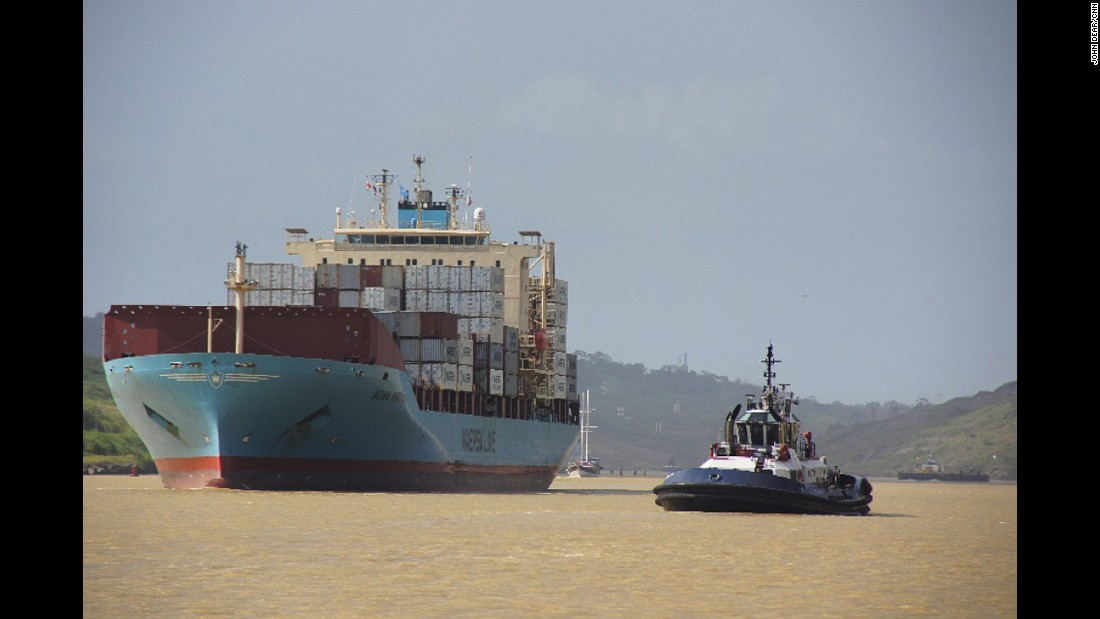"PANAMA: Tugboat and container ship 'Nora Maersk' head towards the Panama Canal's Pedro Miguel Locks after passage through the Culebra Cut. It generally takes a ship 8-10 hours to complete the 48 mile transit from Atlantic to Pacific Ocean (or vice-versa) through the canal. Photo by CNN's John Dear <a href=""http://instagram.com/johndearcnn"" target=""_blank"">@johndearcnn</a>."