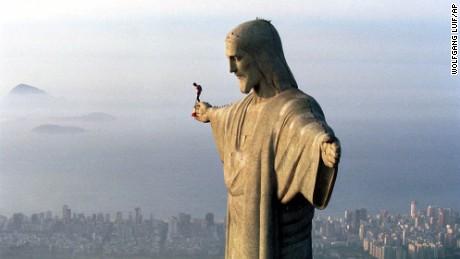 30 year-old Austrian parachutist Felix Baumgartner prepares to jump from the arm of the giant Jesus statue above the Brazilian metropolis Rio de Janeiro, Wednesday, Dec. 1, 1999.