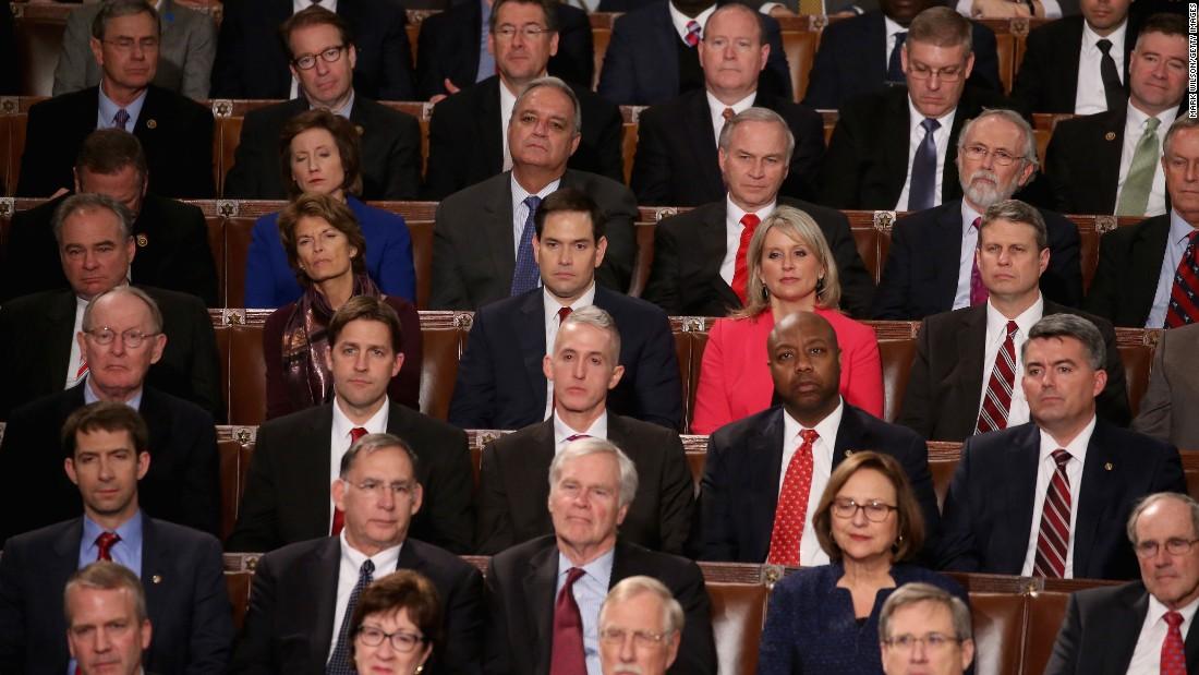 Members of Congress, including Republican presidential candidate Sen. Marco Rubio, center, listen.