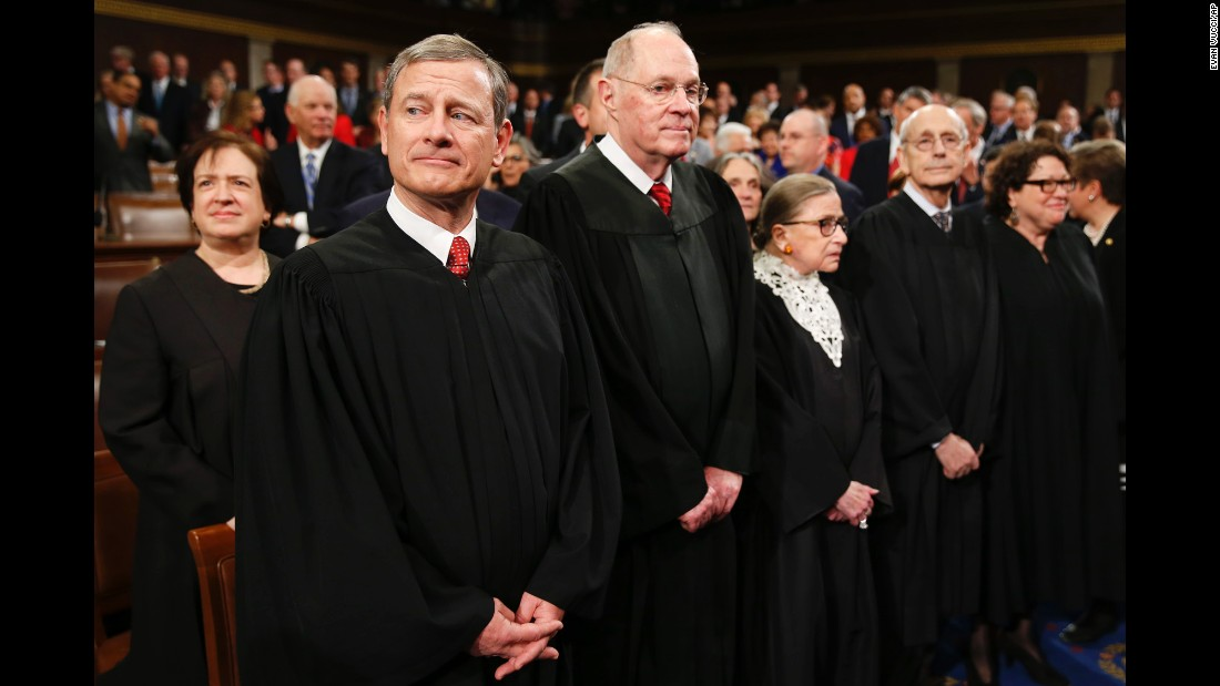 Supreme Court Justice Elena Kagan, from left, Chief Justice John Roberts, Justice Anthony Kennedy, Justice Ruth Bader Ginsburg, Justice Stephen Breyer and Justice Sonia Sotomayor wait for Obama to arrive.