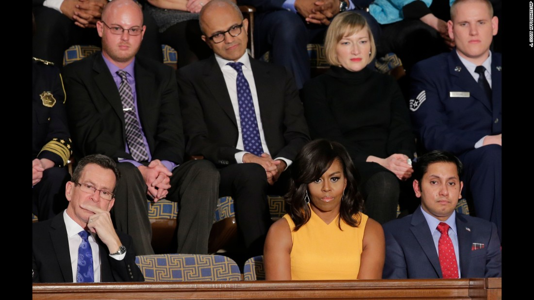 First lady Michelle Obama sits next to a vacant seat to honor victims of gun violence during President Barack Obama's final State of the Union address on Tuesday, January 12. Connecticut Gov. Dannel Malloy is at left and Army veteran Naveed Shah is at right. Behind them, from left, are activist Ryan Reyes, Microsoft CEO Satya Nadella, community college student Jennifer Bragdon and Air Force Staff Sgt. Spencer Stone.