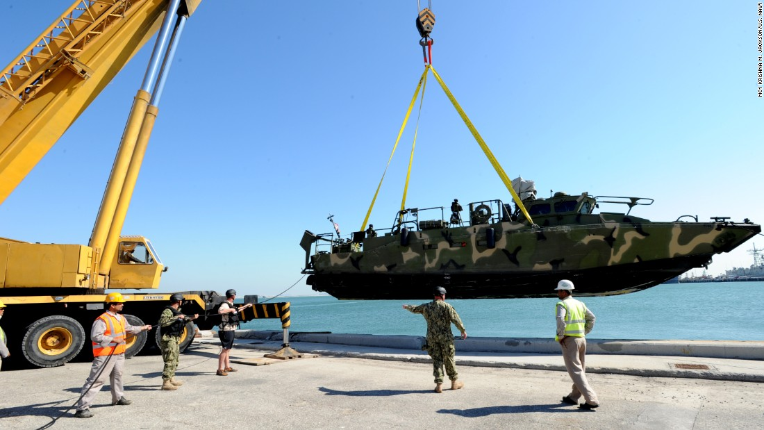 Sailors prepare to launch one of the riverine command boats into the Persian Gulf for the first time in December 2011.