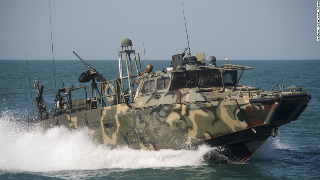 A U.S. boat patrols the Gulf on October 26. Riverine command boats were originally used in shallow-water and tropic environments, but these boats have been repurposed for open-sea patrol.