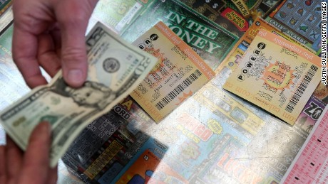 SAN LORENZO, CA - JANUARY 13:  A customer buys Powerball tickets at Kavanagh Liquors on January 13, 2016 in San Lorenzo, California. Dozens of people lined up outside of Kavanagh Liquors, a store that has had several multi-million dollar winners, to -purchase Powerball tickets in hopes of winning the estimated record-breaking $1.5 billion dollar jackpot.  (Photo by Justin Sullivan/Getty Images)