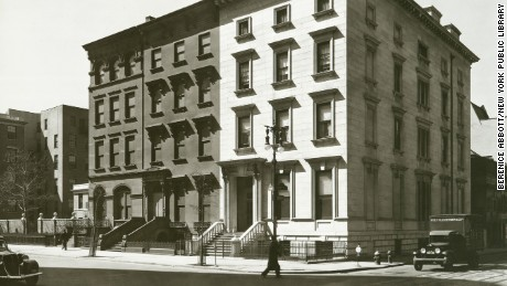 Fifth Avenue, Nos. 4, 6, 8, Manhattan. 1936-03-20 Content : Three large row houses, including one of marble (#8) and traffic on Fifth Ave. and 8th St., and trolley tracks in 8th St.