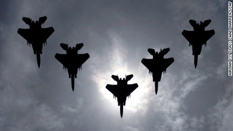 A flight of F-15C Eagles from the 44th Fighter Squadron, Kadena Air Base, Japan, flies during a solar eclipse July 22 over the island of Okinawa. The eclipse was a rare opportunity for servicemembers here to witness this rare event. (U.S. Air Force photo/Airman 1st Class Chad Warren)