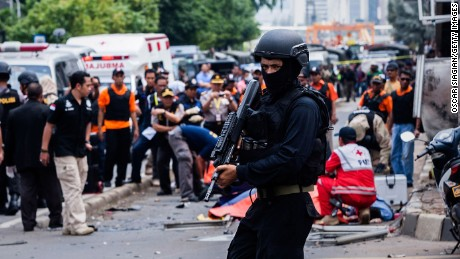 A policeman stands guard in front of a blast site in central Jakarta, capital of Indonesia, on January 14, 2016.