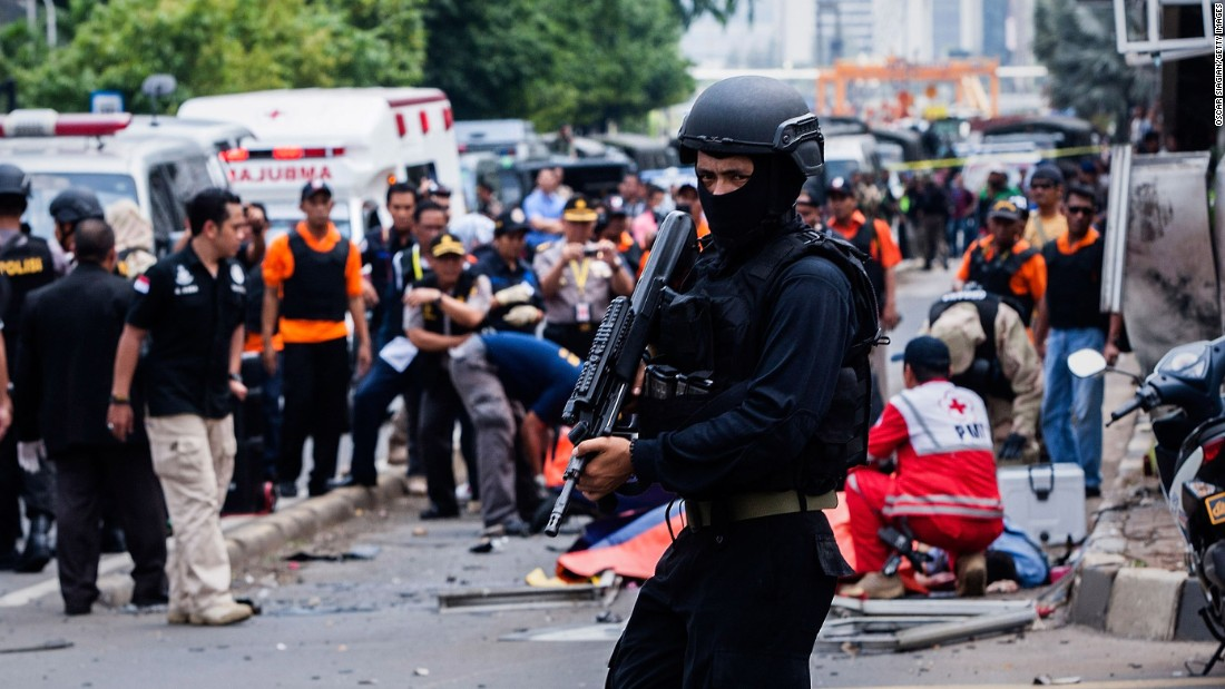 A policeman stands guard in front of a blast site in central Jakarta after a series of explosions rocked the heart of the Indonesian capital on Thursday, January 14.