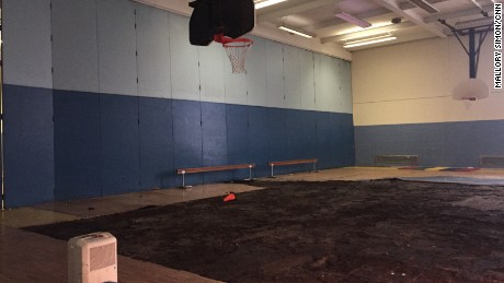 Part of the warped floor was pulled up but never replaced, leaving kids without a gym.