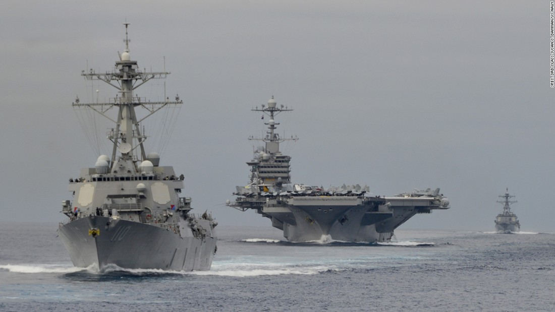 "The Arleigh Burke-class destroyer USS William P. Lawrence (DDG 110) leads the Nimitz-class aircraft carrier USS John C. Stennis (CVN 74) during exercises in the Pacific Ocean in August 2015. On Jan. 15, 2016, the Stennis was to leave its homeport of Bremerton, Washington, as the centerpiece of the Navy's Great Green Fleet. The strike group headed by the Stennis ""will use energy efficiency measures, to include technologies and operational procedures, and alternative fuel in the course of its normal operations,"" the U.S. Pacific Fleet said in a statement. According to <a href=""http://www.biofuelsdigest.com/bdigest/2016/01/07/navy-to-launch-great-green-fleet-with-77-million-gallon-buy-of-cost-competitive-non-food-advanced-biofuels/"" target=""_blank"">a report from Biofuels Digest</a>, the Navy has acquired 78 million gallons of biofuel blends for use by the Great Green Fleet. Click through the gallery to see more U.S. aircraft carriers."