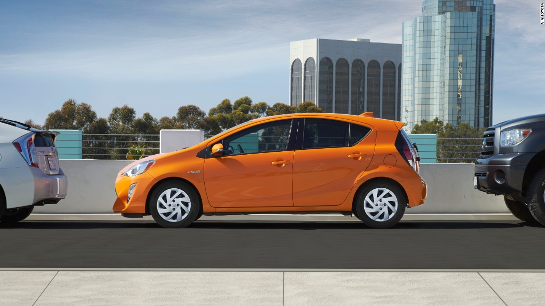 """She loves the Habanero color available for the Toyota Prius C: """"I really fought hard for that. That was five years ago, and it was a huge thing, to receive approval to use this creamy orange color on this cute little car. But now, with the 2016 Prius C, the color has evolved into an even brighter shiny orange we call Tangerine Splash Pearl.<br />"""