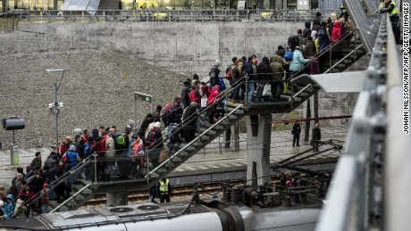 Police organize the line of refugees on the stairway leading up from the trains arriving from Denmark at the Hyllie train station outside Malmo, Sweden, November 19, 2015. 600 refugees arrived in Malmo within 3 hours and the Swedish Migration Agency said in a press statement that they no longer can guarantee accommodation for all asylum seekers.     AFP PHOTO / TT NEWS AGENCY / JOHAN NILSSON    +++   SWEDEN OUT   +++        (Photo credit should read JOHAN NILSSON/AFP/Getty Images)