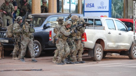 French special forces take position in the surroundings of the Splendid hotel following an attack by Al-Qaeda linked gunmen on January 16, 2016 in Ouagadougou.  Burkina Faso troops supported by French special forces were battling Al-Qaeda linked gunmen in the early hours of January 16 in a Ouagadougou hotel where at least 23 people have been killed. At least 23 people from 18 countries were killed in a jihadist attack that struck the heart of the capital of Burkina Faso, a security source told AFP, adding that the toll could yet rise. / AFP / AHMED OUOBA        (Photo credit should read AHMED OUOBA/AFP/Getty Images)