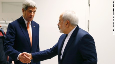 US Secretary of State John Kerry (C) shakes hands with Iranian Foreign Minister Mohammad Javad Zarif (R) after the International Atomic Energy Agency (IAEA) verified that Iran has met all conditions under the nuclear deal during the E3/EU+3 and Iran talks in Vienna on January 16, 2016. The historic nuclear accord between Iran and major powers entered into force as the UN confirmed that Tehran has shrunk its atomic programme and as painful sanctions were lifted on the Islamic republic. / AFP / POOL / KEVIN LAMARQUE        (Photo credit should read KEVIN LAMARQUE/AFP/Getty Images)